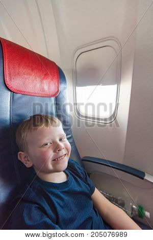In The Cabin Of The Plane The Boy