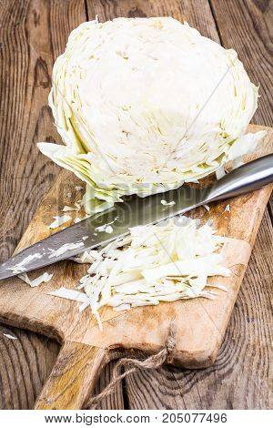 Cutting vegetables on wooden cutting board for cooking. Studio Photo