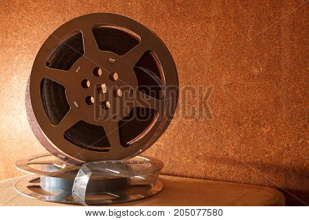 Two coils with a film on a wooden background
