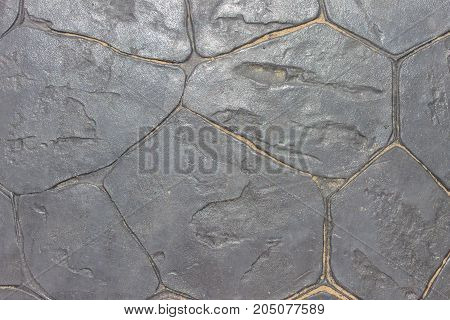 Texture of a dark coating or stones with sand