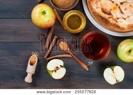 Apple Pie And Tea On A Wooden Table