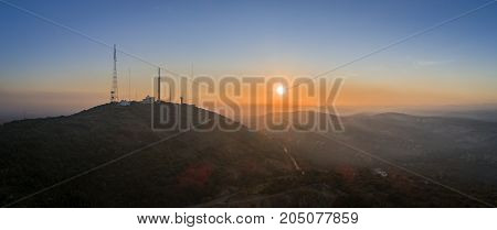 Sunset aerial countryside landscape view of Cerro Sao Miguel hill Algarve destination region Portugal.