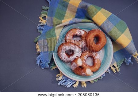Plate with delicious donut on wooden background