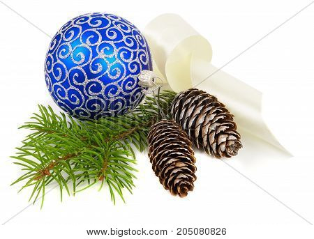 Christmas decoration of blue ball with cones and fir tree branch isolated over white background