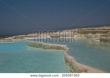 View of travertine hot springs in Pamukkale Turkey selective focus.