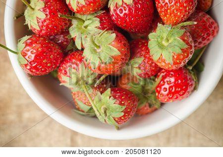 Fresh strawberries fruit in a bowl.Healthy fruit