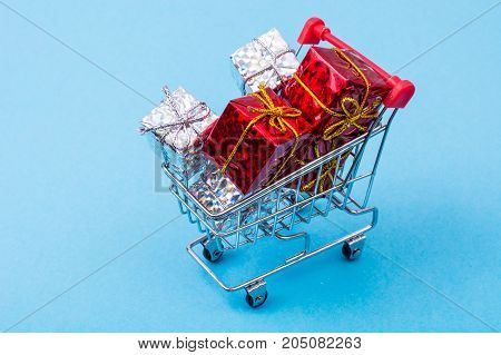 Christmas shopping on bright colorful background. Studio Photo
