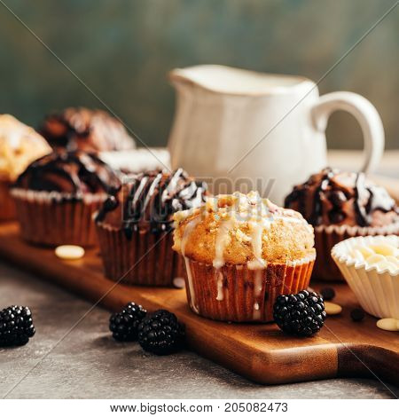 Different homemade muffins with chocolate and berries, selective focus.