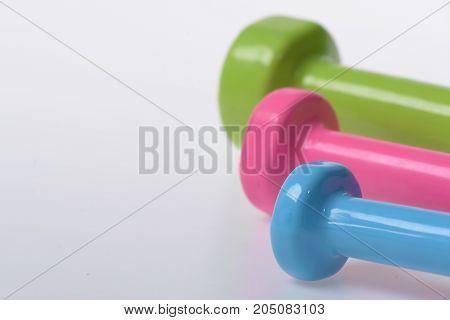 Sport Regime Symbols. Barbells In Pink, Green And Blue Colors