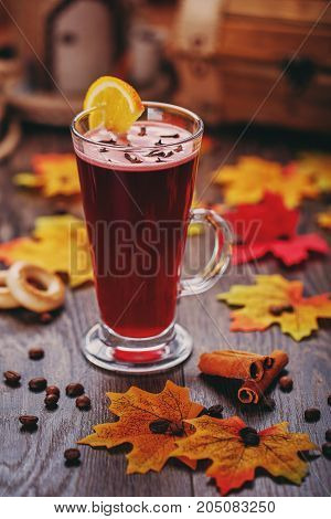 Traditional mulled wine with spices, cinnamon and lemon. Autumn atmosphere picture