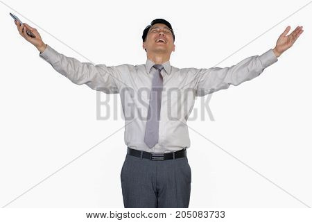 Businessman raising his arms, Smiling man standing with open arms isolated on a white background