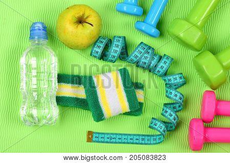 Dumbbells, Apple, Water Bottle And Cyan Measure Tape