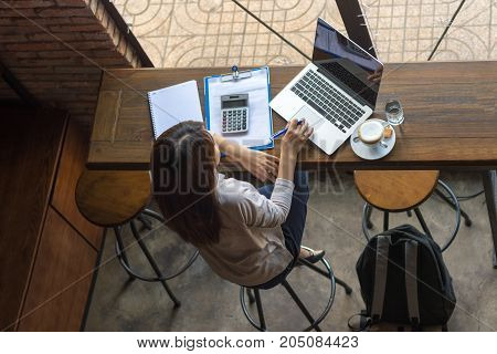 Asian freelancer working on laptop at the cafe