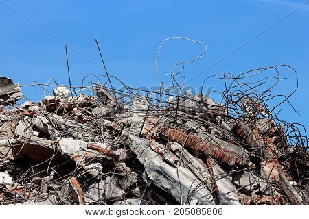 Pile of rubble from a dismantled building at a demolition site.