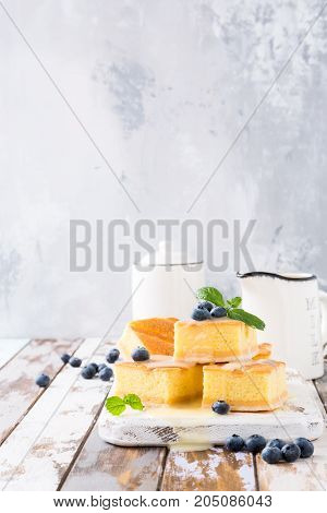 Healthy dessert. Homemade pudding cake with custard cream and blueberries. Sweet gluten free food. Copy space.