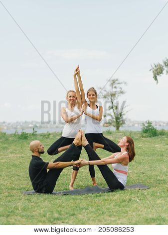 Group free exercise class for people of different age and gender in the city park.