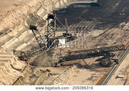GARZWEILER GERMANY - Bucket-wheel excavator mining lignite (brown-coal) in the Garzweiler open pit mine from RWE Tagebau.