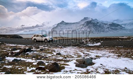 SUV car driving through Iceland during Winter