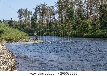 Fishing on the mountain river with fast current