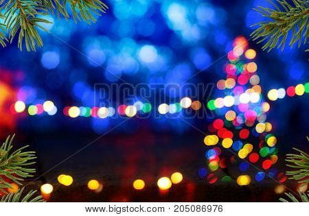 Blue Christmas Background with Christmas Tree and Needles.