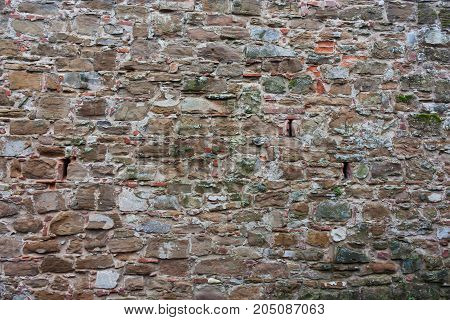 Texture Of Brown With Green Mold Of Stone. Old, Medieval Wall Of A Building In Italy.