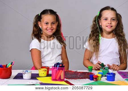 Artists With Ponytails Create Art Ideas. Girls With Concentrated Faces