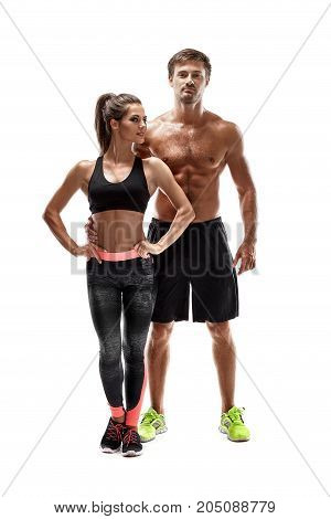 Young sportsmen couple woman and man in studio on white background. A man looks at the camera