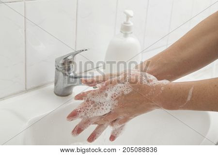 Close up of a woman washing hands. Selective focus
