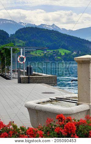 Beautiful view on the lake Luzern and pier in the city of Vitznau Switzerland