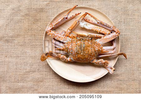 Steamed crab on wood dish in home party