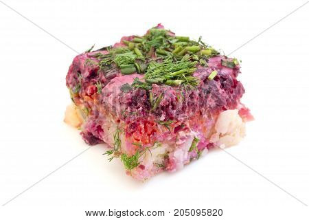 Russian Shuba (beet salad with herring) on a white background