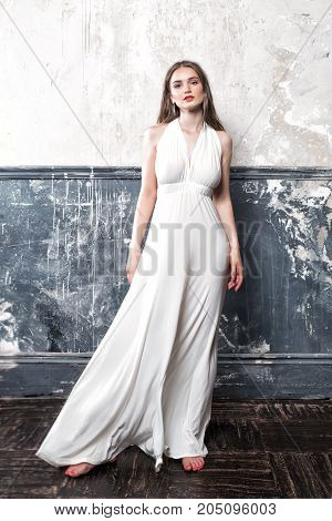 Young Woman Fashion Model Wearing White Dress on Vintage Background