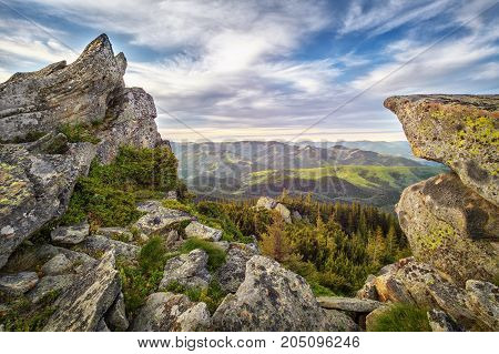 Landscape with rock in mountains forest at sunset. HDR foto
