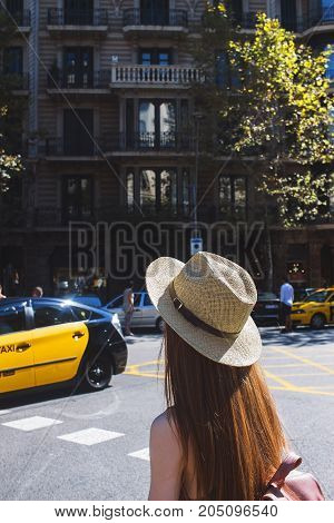 Girl in the city. Road and cars. Traffic in center of town. Urban lifestyle