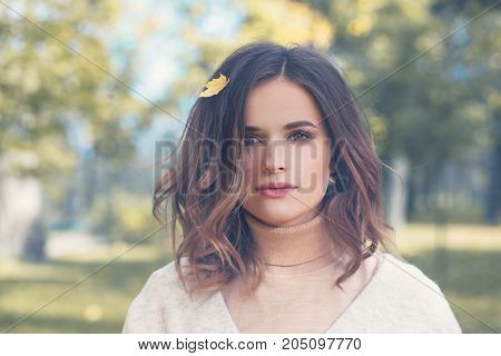 Pretty Autumn Woman Model with Brown Wavy Hair Fall Fashion Girl Outdoors