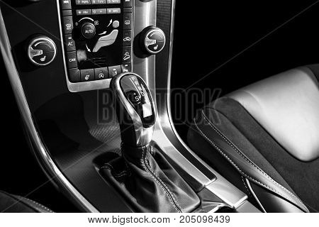 Automatic gear stick of a modern car car interior details with electronic components. Black and white
