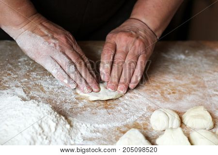 Female Hands Making Dough For Pizza