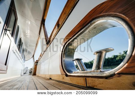Fairlead and the mooring bollard element on the deck of a luxury wooden yachts.