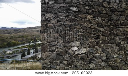 Fortress wall. Grunge background.Fragment of a stone fortress wall. Stone background.  Stone texture.