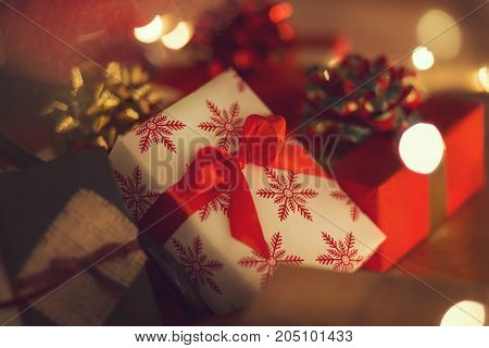 Nicely decorated Christmas presents placed underneath the Christmas tree. Selective focus