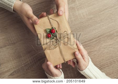 Top view of a couple exchanging Christmas presents. Selective focus