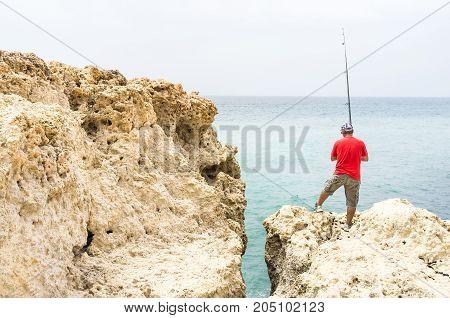 Fisherman on coast, Fishing man symbol, Fisherman by the sea, Fisherman on Portuguese coast