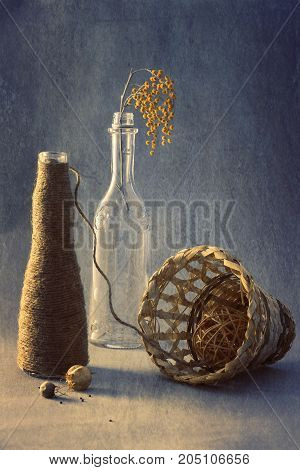 Still life with mimosa.Mimosa in glass bottles and linen thread