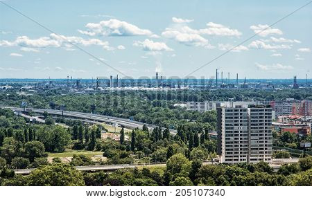 Slovnaft refinery in Bratislava Slovak republic. Pollution theme. Factory chimneys. Photo filter.