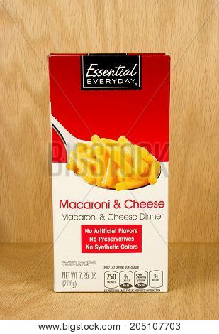 RIVER FALLS,WISCONSIN-SEPTEMBER 2,2017: A box of Essential Everyday brand cheese and macaroni with a wood background.