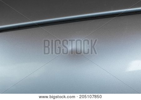 Bump on car with silver paint picture