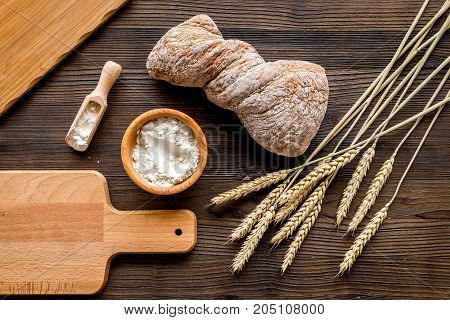 bakery shop set with fresh wheaten bread on table rystic background top view mock-up