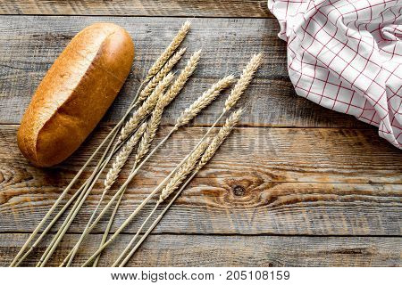 baking bread with wheat flour and ears on table rystic background in bakery top view mockup