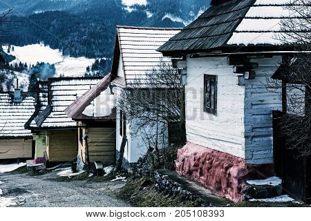 Beautiful wooden houses in Vlkolinec village Slovak republic Unesco. Cultural heritage. Travel destination. Cold photo filter.