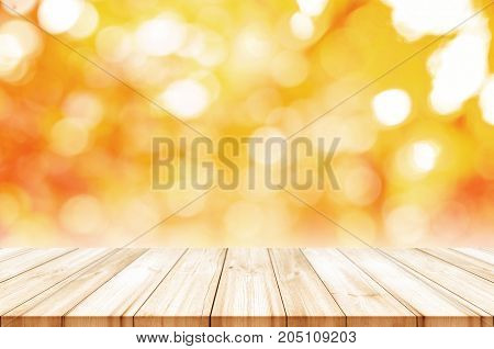 Empty Wooden Table Top With Blurred Autumn Abstract Background.